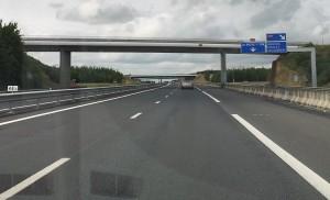 Bridge cladding and road edge markings