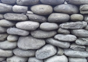 Irish dry stone walls. Rounded stones.