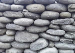 Irish dry stone walls. Rounded stones.